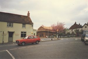 Brading. View from the Bull Ring showing new building in New Road and a later view. 1988. Photograph.