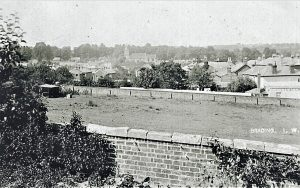 Brading view from Wrax Road looking towards St Mary's Church. Rear of New Inn on right. Photograph.