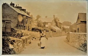Brading. West Street showing the entrance to Stay's smithy on the left and the cottages that were demolished when the Council School was built in 1910. Postcard. The 2020 photograph shows Summer's Hall and the Slaughter House still standing