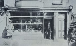 Brading. High Street,'Deacons' poultry and vegetable shop. Photograph