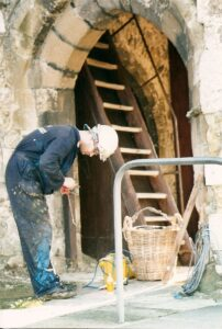 Workman in St Mary's Church porch November 1996