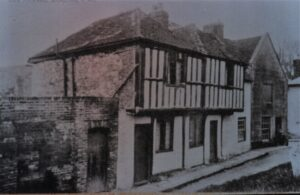 "Photo of postcard ""Old Houses Brading"" (waxworks), undated. SB 018."